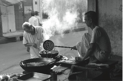 Cooking street food in India