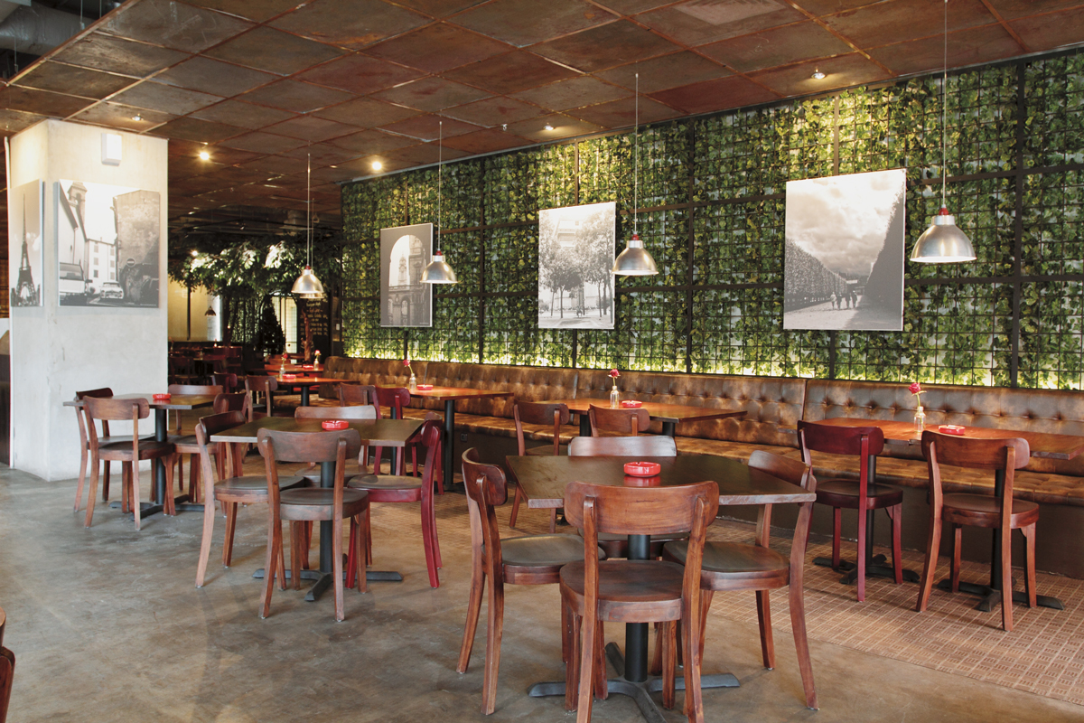 The Restaurants Interiors Are Chic But Rustic With Industrial Design Elements Complementing Exposed Bricks A Bright Green Vine Wall And Cement Floors