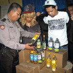 Rihanna and Agan Harahap in a police station in Indonesia