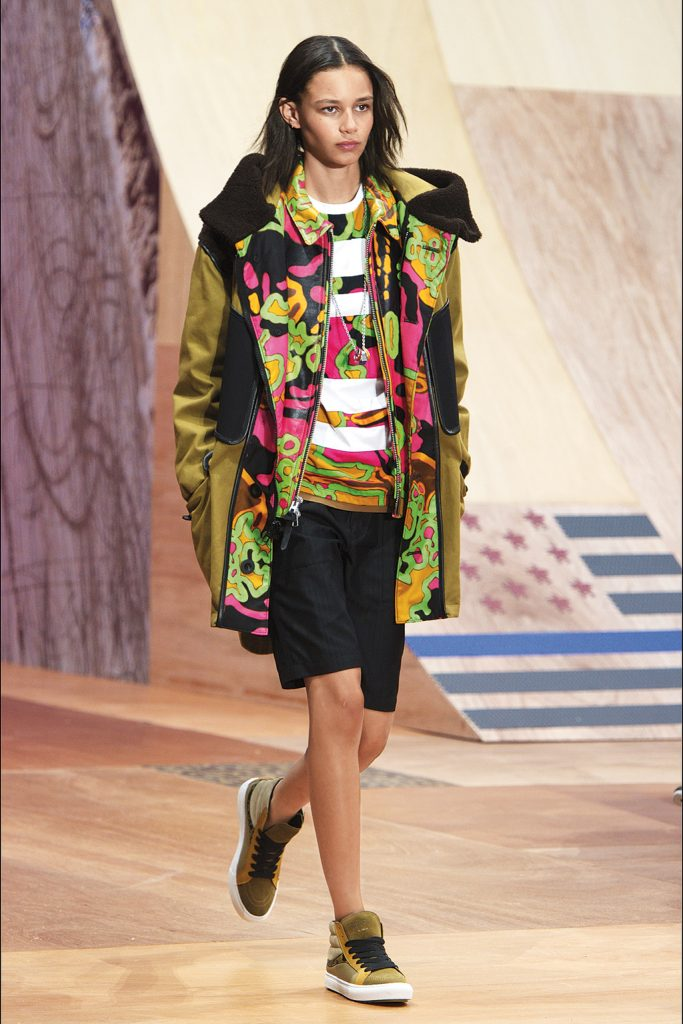 Female model Binx Walton wearing one of Coach's psychadelic jackets;