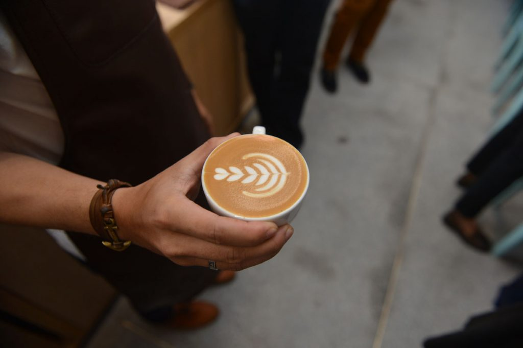 Indonesian Award-winning Barista made Latte Art proving the quality and technique of person serving your coffee at ST