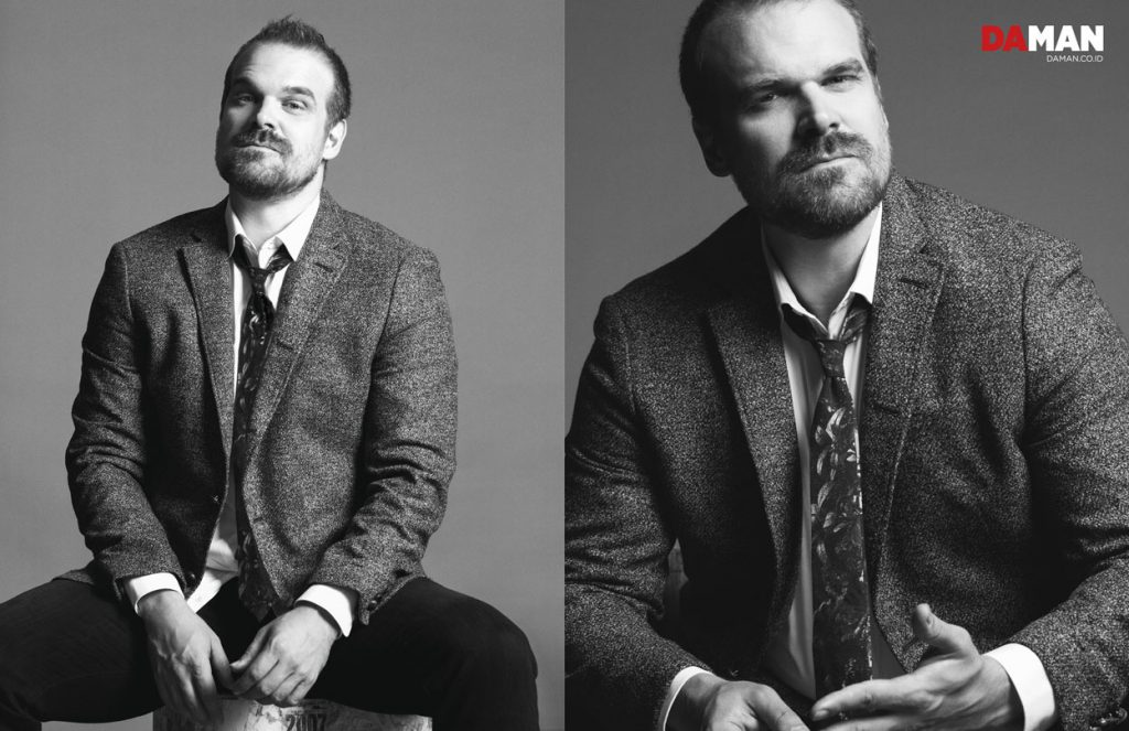 David Harbour of Netflix's Stranger Things in Blazer and shirt by John Varvatos Star USA, tie by Eton, denim trousers by AG Jeans