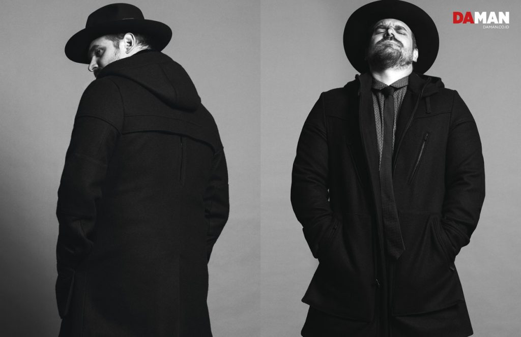David Harbour of Netflix's Stranger Things in Coat, shirt and tie by Robert James, hat by Worth & Worth