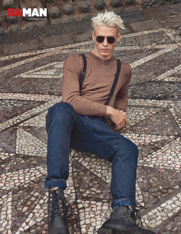 Model Oliver Stummvoll by GREG SWALES in Sweater by Ralph Lauren, denim trousers by Diesel, sunglasses by Ray-Ban by Luxotica, shoes by Giorgio Armani