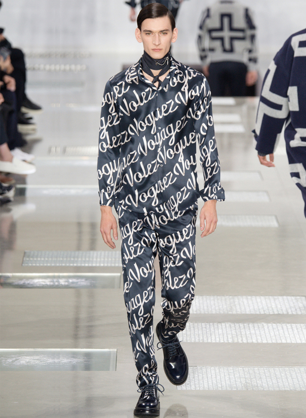 "Louis Vuitton's slogan, ""Volez, Voguez, Voyagez,"" emblazoned on the clothes"