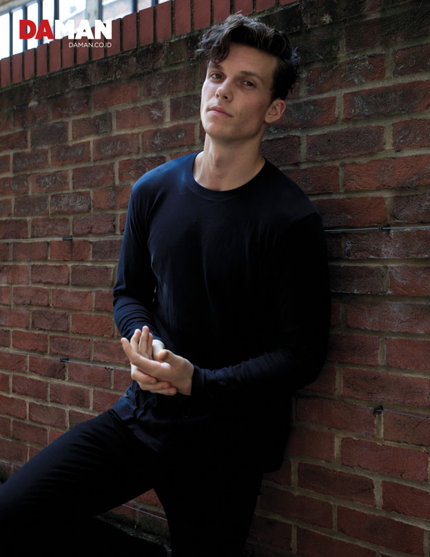 Model Sam Tingman in Top by Uniqlo and denim trouses by Levi's
