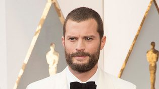 Jamie Dornan in an Hermès suit and Tod's shoes with a Cartier watch