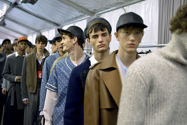 backstage during Louis Vuitton's fall/winter runway show