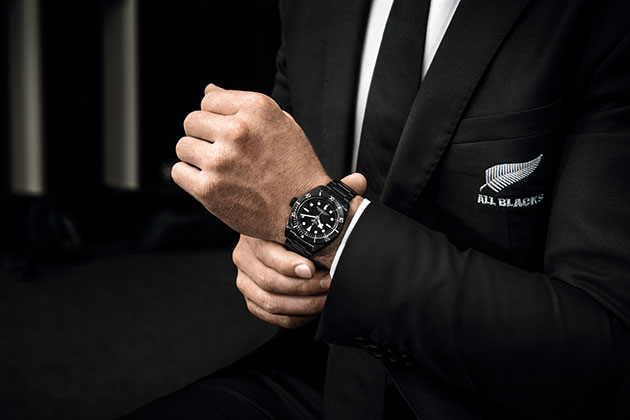 The Tudor Black Bay Dark contrasted against the All Blacks' silver fern emblem