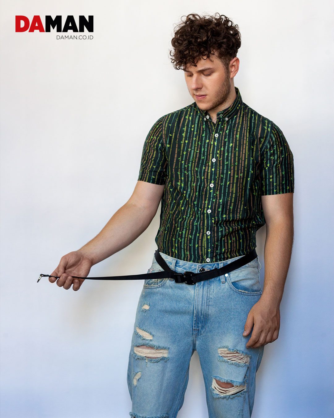 Shirt by Oxford Lads; jeans by Guess; belt by Atomic Mission Gear