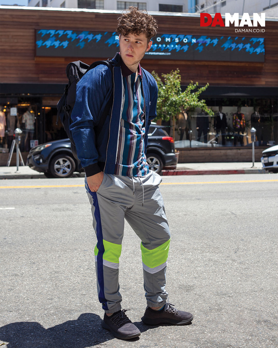 Jacket by Charles & Ron; shirt by 4 Funky Flavours; pants by Guess; backpack by Atomic Mission Gear; shoes by All Birds