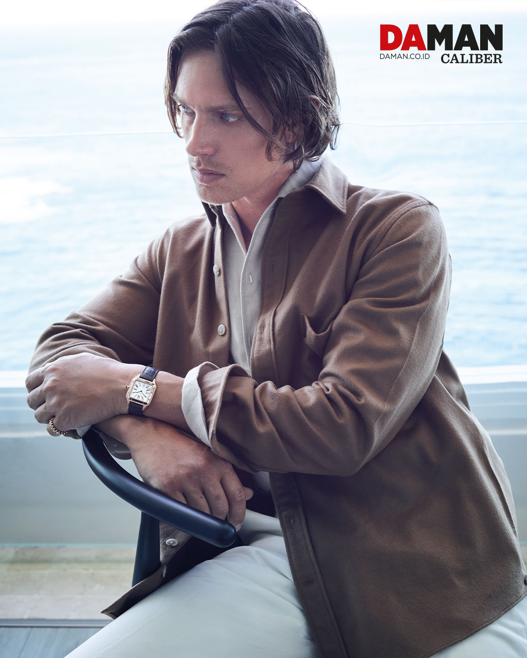 Santos Dumont in rose gold with leather strap, Clash de Cartier ring in rose gold / Outfit by P Johnson