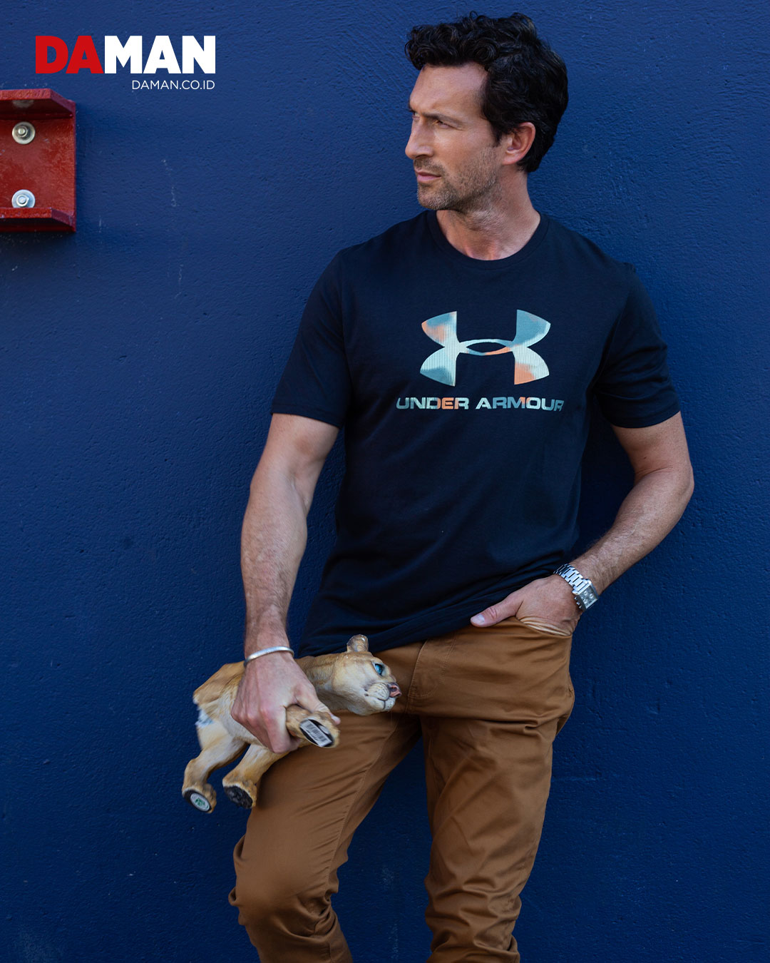 t-shirt by under armour; pants by dockers, watch by esQ, bracelet by buck Palmer