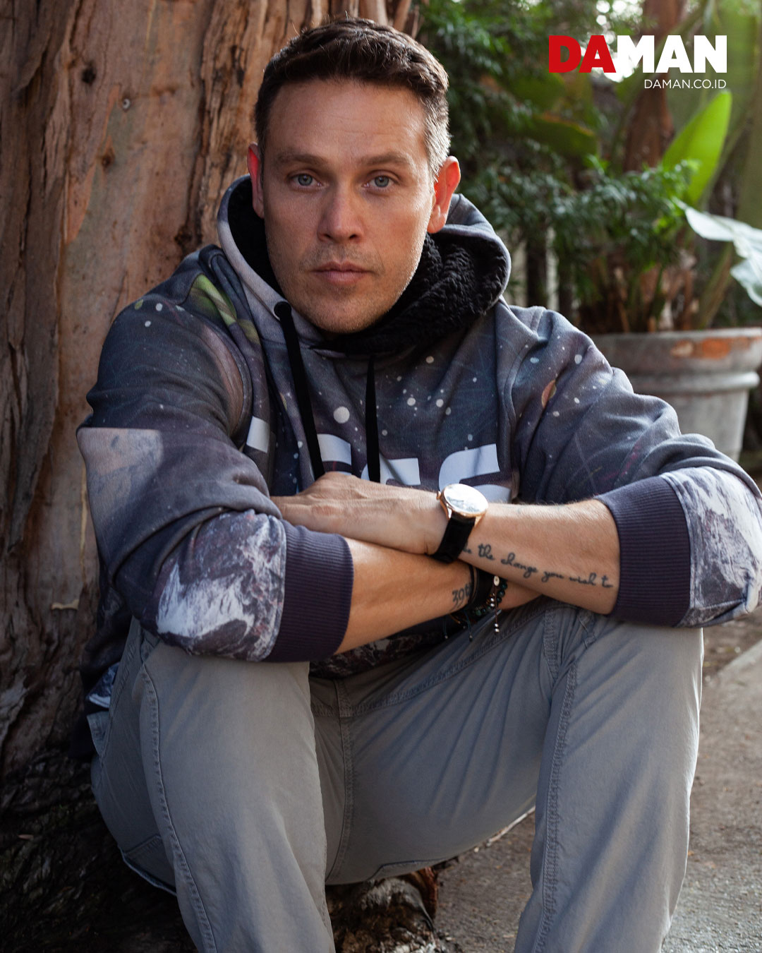 Hoodie by Guess; pants by J crew; watch by Rolex 'Cellini'; leather bracelet by Hermés