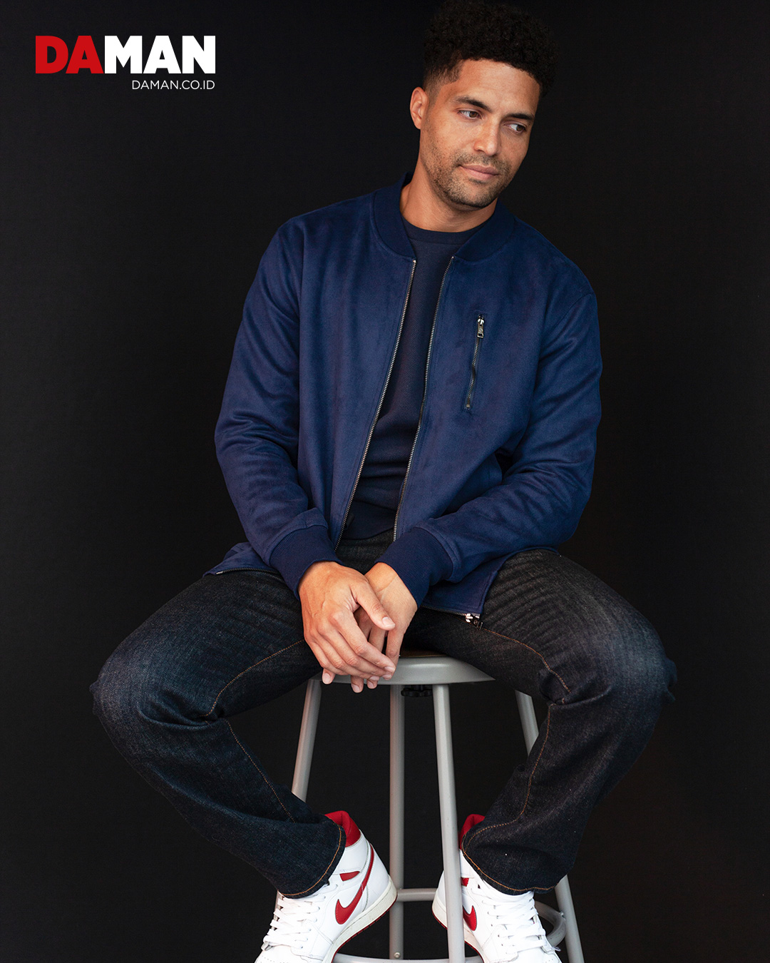 Jacket by Ben Sherman; pants by Polo Ralph Lauren; pullover by John Varvatos; pants by Polo Ralph Lauren; shoes by Nike