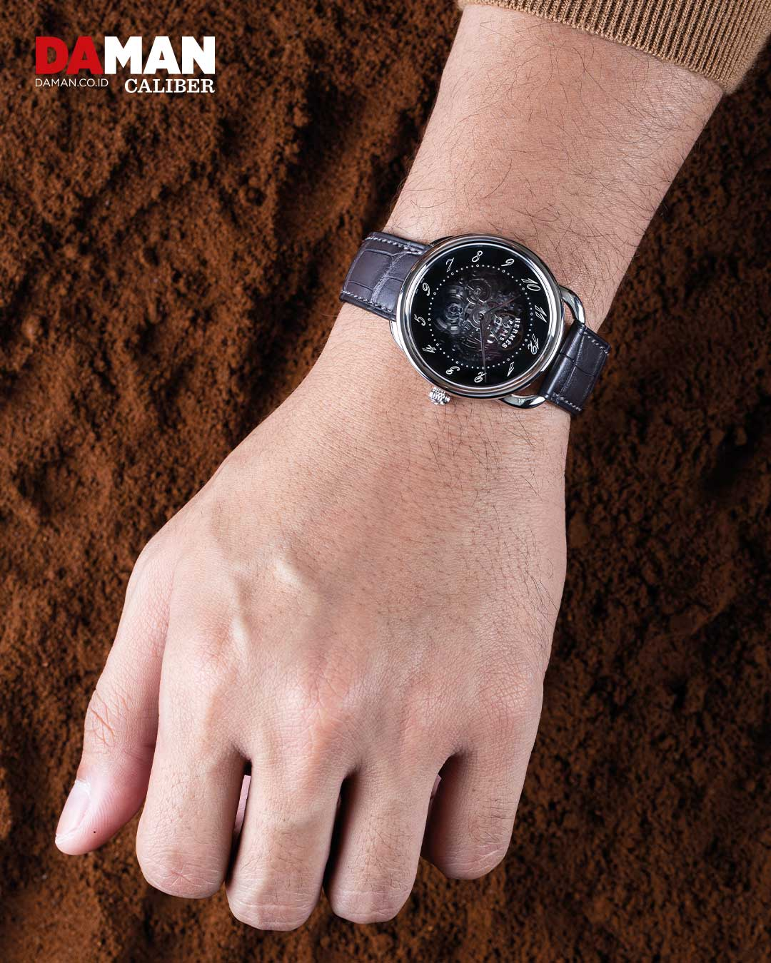 Arceau Squelette in stainless steel with long single tour strap in matte black alligator leather