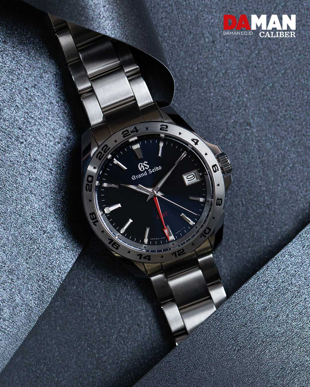 Grand Seiko Sport Collection GMT SBGN005 in stainless steel with steel bracelet