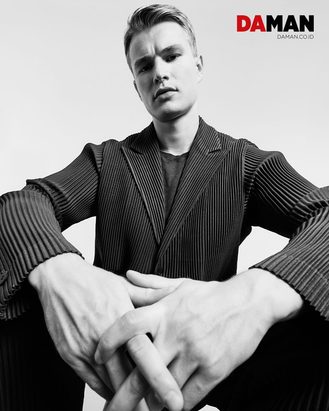 On Frederic: Jacket and pants by Homme Plissé Issey Miyake / T-shirt by Standard Project