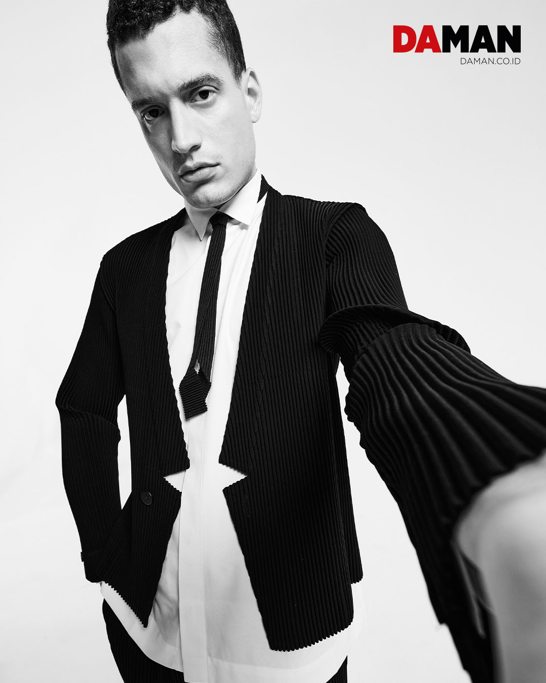 On Kevin: Outfit by Homme Plissé Issey Miyake